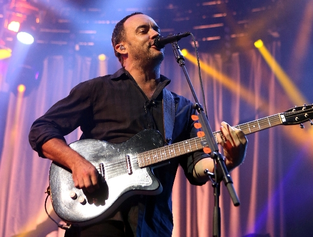 In this photo Dave Matthews of The Dave Matthews Band performs on stage at the Susquehanna Bank Center in Camden, N.J. Emily Kraus, one of Matthew's fans pulled over to give a stranded cyclist a r ...