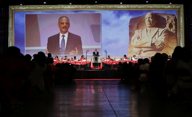Attorney General Eric Holder speaks at the Delta Sigma Thetas Social Action luncheon, part of the sorority's 51st National Convention in Washington, Monday. Holder said the killing of Trayvon Mart ...