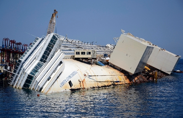 The Costa Concordia cruise ship lies on its side in the Tuscan Island of Isola del Giglio, Monday. S