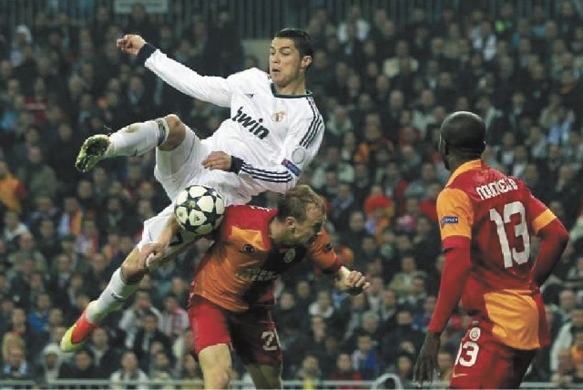 Cristiano Ronaldo gets airborne while challenging Semih Kaya for the ball in Real Madrid's 3-0 win over Galatasaray on April 3 in Madrid.