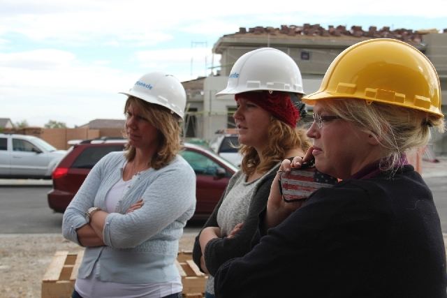 Meri, Mariah and Janelle Brown stand at the site of their new homes.
