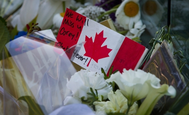 A note is written on a Canadian flag placed among flowers at a memorial for Canadian actor Cory Monteith outside the Fairmont Pacific Rim Hotel in Vancouver, British Columbia on Monday. Monteith,  ...