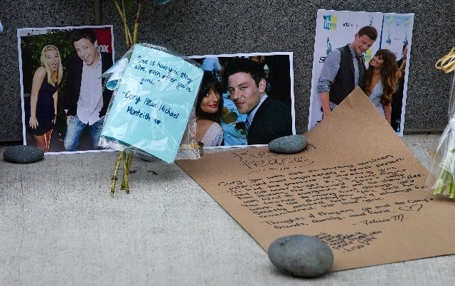 Photographs and notes are placed at a memorial for Canadian actor Cory Monteith outside the Fairmont Pacific Rim Hotel in Vancouver, British Columbia on Monday. Monteith, 31, was found dead in his ...