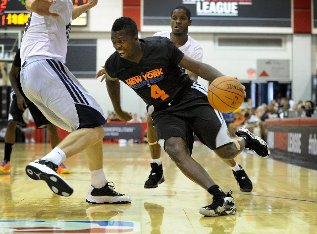 New York Knicks' J'Covan Brown wears a new style jersey as he drives to the basket against Charlotte during a NBA Summer League basketball game at the Cox Pavilion on Monday, July 15. Adidas rolle ...