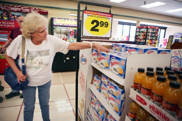 Dee Rodgers grabs a box of Hostess Twinkies at Smith's grocery store located at 850 S. Rancho Drive Monday in Las Vegas. Apollo Global Management and Metropoulos & Company purchased the snack cake ...