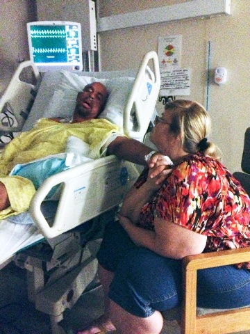 Daniel Sanders lies in a bed at Valley Hospital Medical Center, 620 Shadow Lane, in June while his wife, Charlotte, sits at his side. Sanders, a northwest Las Vegas resident, benefited from having ...