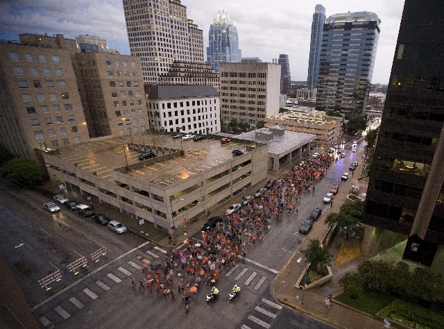 Abortion rights advocates march through downtown Austin, Texas to protest recent legislation that could shut down all but five abortion clinics and restrict abortion rights throughout the state on ...