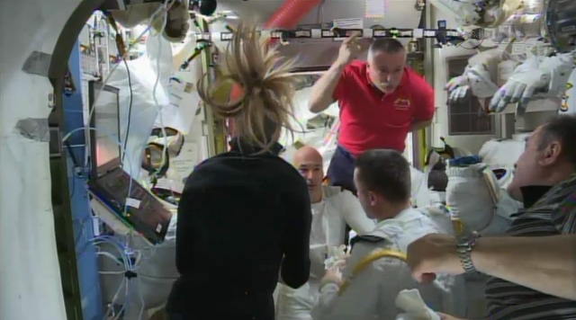 In this image from video made available by NASA, astronauts discuss the aborted spacewalk aboard the International Space Station on Tuesday. A dangerous water leak in the helmet of Luca Parmitano, ...