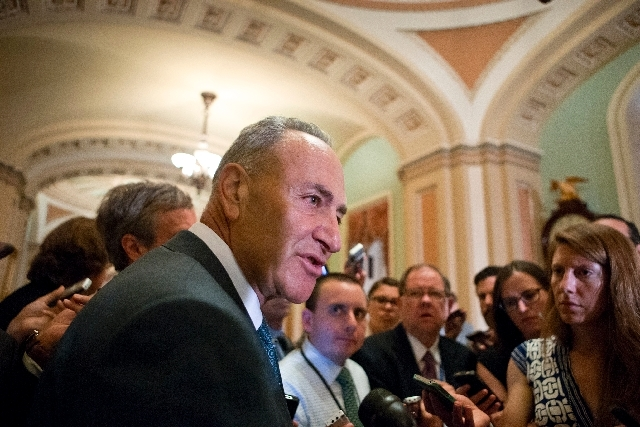Sen. Chuck Schumer, D-N.Y., chairman of the Senate Rules Committee, speaks with reporters just off the Senate floor as lawmakers moved toward resolving their feud over Republican filibusters of Wh ...