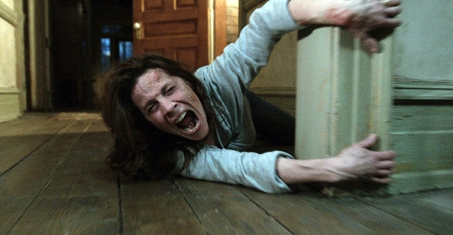 """In this publicity image released by Warner Bros. Pictures, Lili Taylor portrays Carolyn Perron in a scene from """"The Conjuring."""" The film opens nationwide on Friday."""