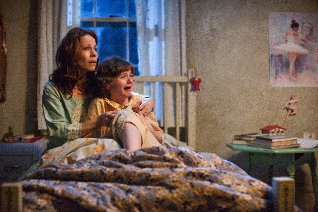 """In this publicity image released by Warner Bros. Pictures, Lili Taylor portrays Carolyn Perron, left, and Joey King portrays Christine in a scene from """"The Conjuring."""""""
