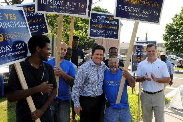 Bill Hornbuckle, third from right, president of MGM Resorts International, and Jim Murren, Chairman and CEO of the company, right, gather with supporters Tuesday in front of the Rebecca Johnson Sc ...
