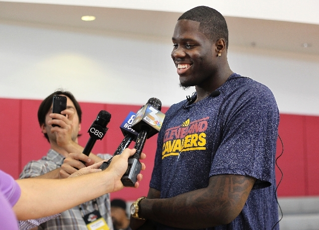 Anthony Bennett, answering questions at the Mendenhall Center on the UNLV campus in Las Vegas on Tuesday, says he hasn't spent any big money on himself yet. He's waiting for his mom to make a deci ...