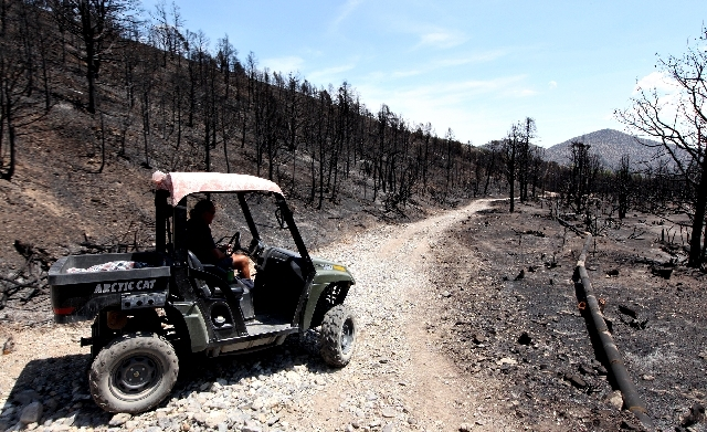 Don Kubinski, a Trout Canyon resident, drives his ATV on Tuesday near a break in the water line that supplies about 20 residents. Kubinski says he was told that there are nearly 50 breaks in the w ...