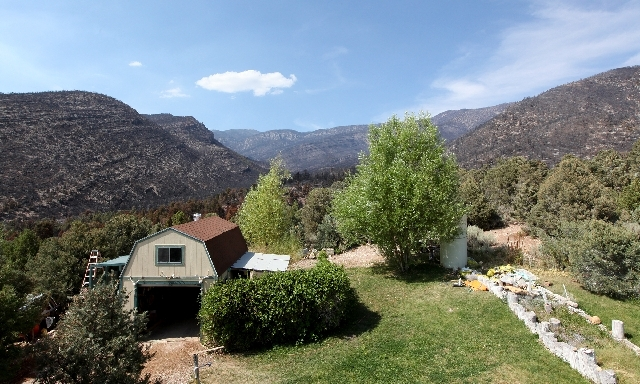 This is the view from Don Kubinski's balcony in Trout Canyon on Tuesday. The Carpenter 1 Fire came within 50 yards of his property.