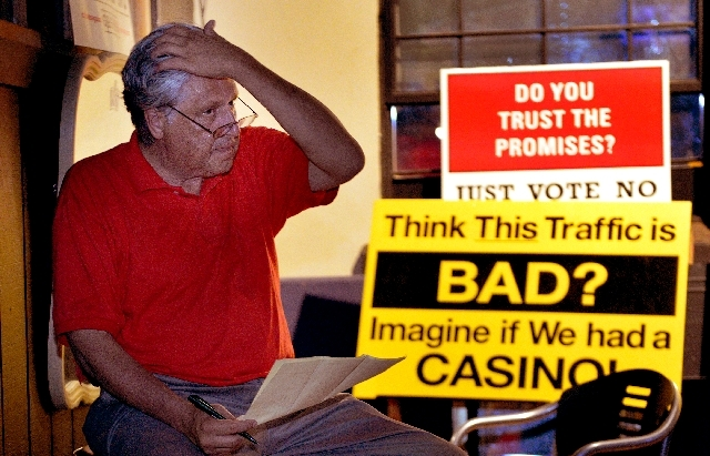 Michael Kogut of the Citizens Against Casino Gaming checks out the casino vote at Gasoline Alley in Springfield, Mass. The opposition to a Springfield casino came up short in Tuesday's election.