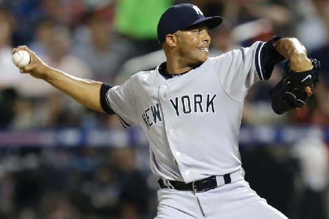 The American League's Mariano Rivera, of the New York Yankees, pitches during the eighth inning of the MLB All-Star baseball game on Tuesday. Rivera was left alone on the field for a 90-second ova ...