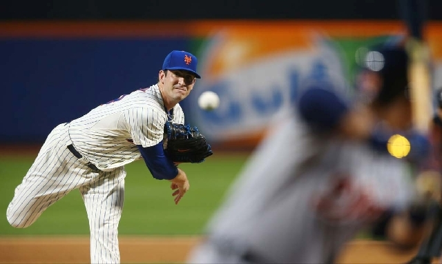The National League's Matt Harvey, of the New York Mets, pitches during the first inning of the MLB All-Star baseball game on Tuesday in New York.