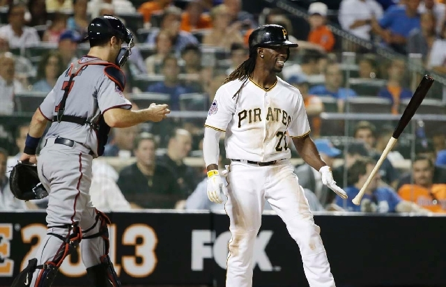 The National League's Andrew McCutchen, of the Pittsburgh Pirates, flips his bat after striking out to end the sixth inning of the MLB All-Star baseball game on Tuesday in New York. Left is Americ ...