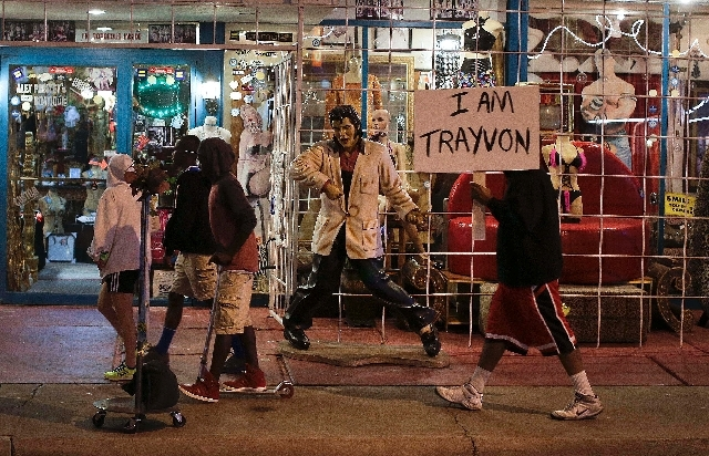 """Demonstrators walk along Las Vegas Boulevard for a  a """"Justice for Trayvon"""" march, Tuesday, July 16 near Las Vegas. Following George Zimmerman's Florida acquittal in the shooting death of Trayvon  ..."""