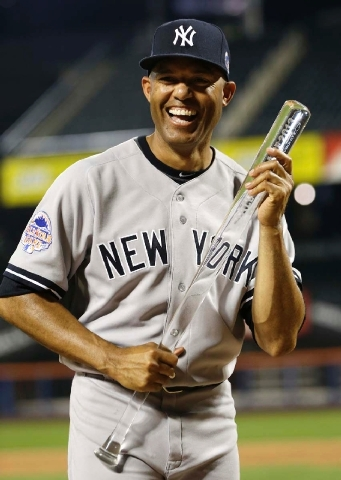 The American League's Mariano Rivera, of the New York Yankees, poses with the MVP trophy after the MLB All-Star baseball game on Tuesday in New York. The American League defeated the National Leag ...