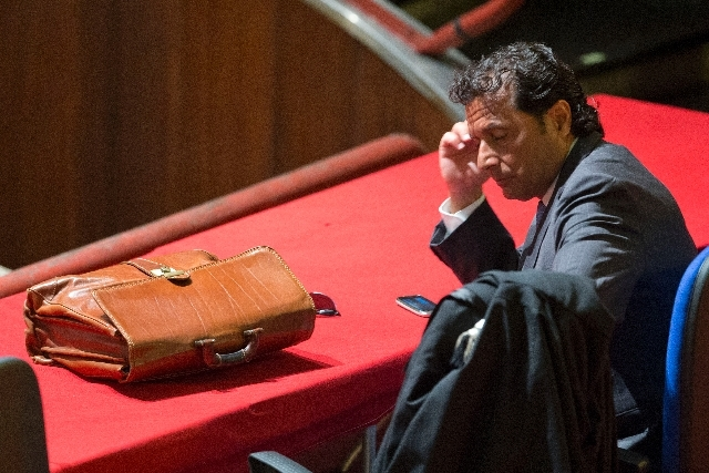 Captain Francesco Schettino sits in the court room of the converted Teatro Moderno theater for the start of his trial, in Grosseto, Italy, Wednesday.