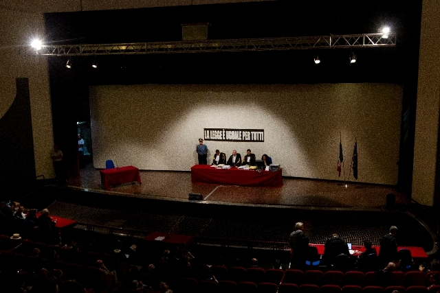 Court President, Judge Giovanni Puliatti, sitting at center, is flanked by judges Sergio Compagnucci, right, and Marco Mezzaluna, left, are seen on the stage of the Teatro Moderno theater, convert ...