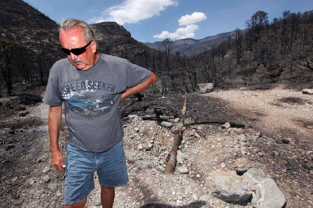 Don Kubinski, a Trout Canyon resident, stands next to a break in the water line that supplies the roughly 20 residents of Trout Canyon. Kubinski says he was told that there are nearly 50 breaks in ...