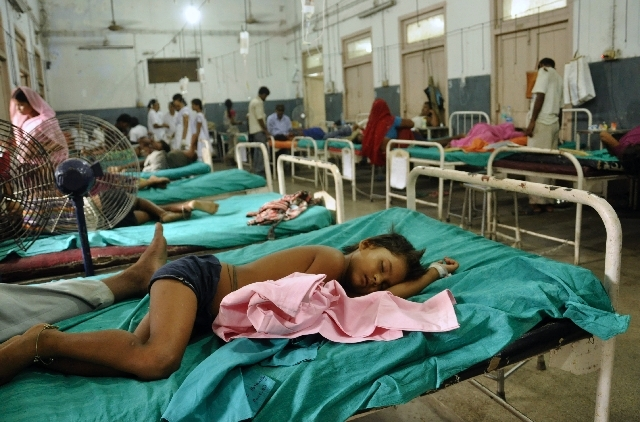 Indian children who fell sick after eating a free school lunch lie at a hospital in Patna, India, Wednesday.