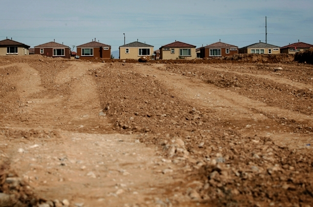 Homes are seen behind land being graded at Serenada by Harmony Homes on March 25.
