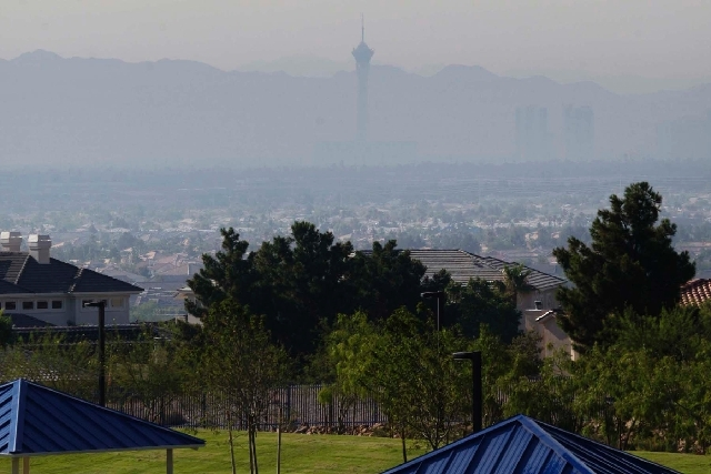 Smoke from the Carpenter 1 Fire almost renders the Stratosphere invisible July 9 when looking southeast from Lone Mountain Road and the Las Vegas Beltway in the northwest.
