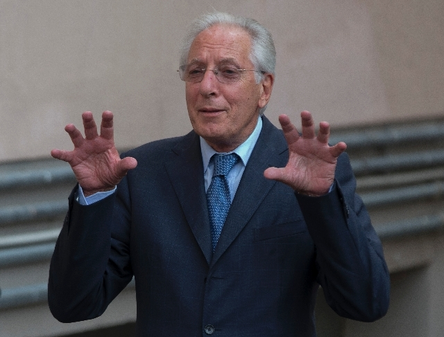 Chief prosecutor Francesco Verusio gestures as he leaves at the end of a hearing of Captain Francesco's trial, in Grosseto's converted Teatro Moderno, Italy, Wednesday.