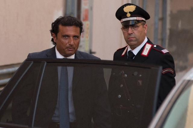 Captain Francesco Schettino leaves at the end of an audince of his trial, in the court room of the converted Teatro Moderno theater, in Grosseto, Italy, Wednesday.