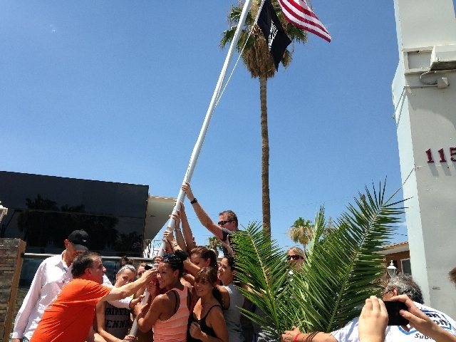 Arnold Stalk, at left in front, and a group of volunteers from ChoiceCenter Leadership University's LV130 Leadership Team install a flagpole July 13 at Veterans Village, 1150 Las Vegas Blvd. South.