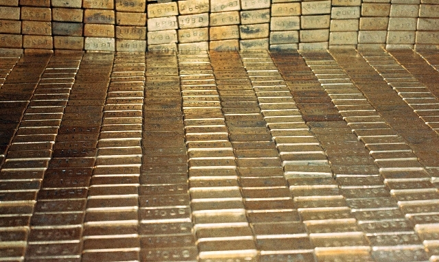 In a Sept. 24, 1974 file photo gold bars are seen at the U.S. Depository in Ft. Knox, Ky.  A new study based on observations from space suggests the gold on Earth came from colliding dead stars in ...
