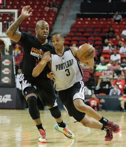 Trail Blazers guard C.J. McCollum drives against Suns forward P.J. Tucker in Portland's 82-69 loss Saturday in an NBA Summer League game. McCollum, the No. 10 pick in June's draft, had 22 points a ...
