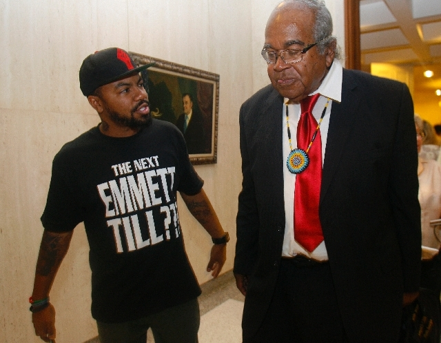 Phillip Agnew, with Dream Defenders, speaks to civil rights lawyer and activist John Due Wednesday outside Florida Gov. Rick Scott's office in the Capitol in Tallahassee, Fla.