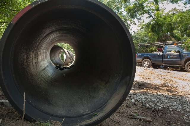A replacement water pipe sits at the Washington Suburban Sanitary Commission sight were workers are removing dirt from around a defective 4-1/2 water main in District Heights, Md., Wednesday, July ...