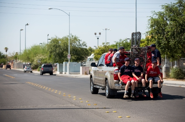 Las Vegas Baseball Academy athletes ride in the back of coach Mike Martin's truck, an annual tradition before the young ball players visit the National Baseball Hall of Fame in New York.