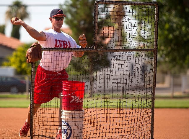 Mike Martin, a former Chicago Cubs catcher, leads a  practice for Las Vegas Baseball Academy athletes Wednesday. Martin and Jerry DeSimone both former Las Vegas Stars players, started the youth ac ...
