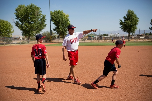 Mike Martin, a former Chicago Cubs catcher, leads a Las Vegas Baseball Academy practice Wednesday at Potosi Park. Martin, who co-founded the academy in 1983, was diagnosed with bladder cancer last ...