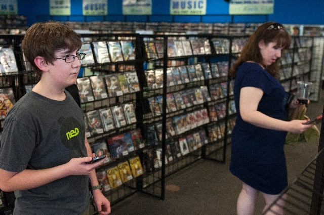 Ethan Duggan, 12, and his mother Marni Klein, browse for video games Wednesday at Buybacks in Henderson. Duggan is an app developer who will present his apps at SXSW conference at the Cosmopolitan ...