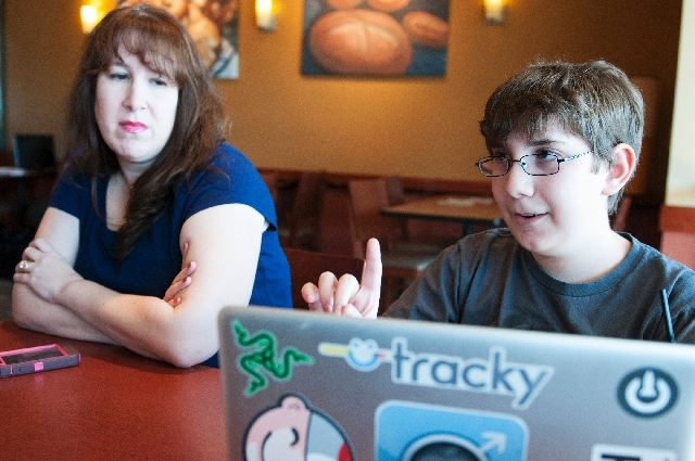 Ethan Duggan, 12, with his mother Marni Klein, explain several of the apps that he has developed Wednesday at Panera Bread cafe in Henderson. Duggan is an app developer who will present his apps a ...