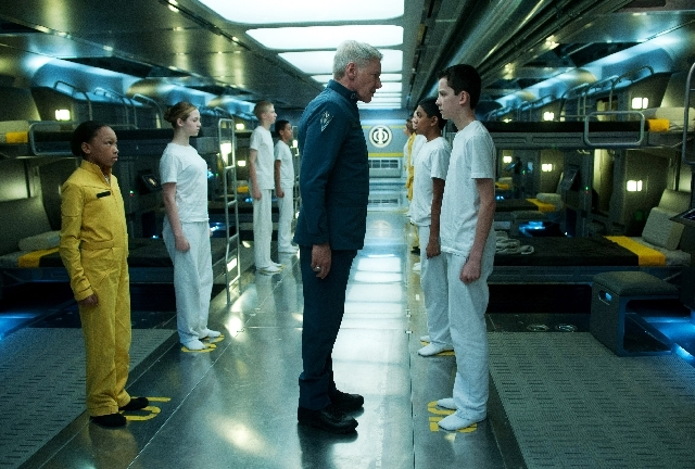 "This publicity photo released by Summit Entertainment shows Harrison Ford, center, and Asa Butterfield, right, in a scene from the film, ""Ender's Game."""