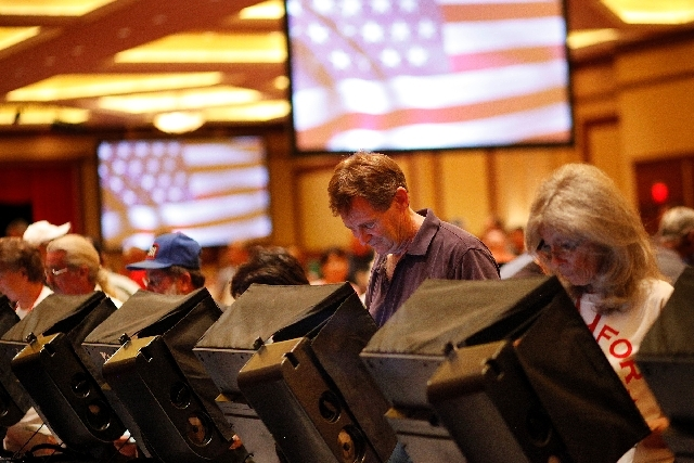 Ronald Solomon, in purple shirt, and others vote for candidates for the Clark County Republican Central Committee at the South Point in Las Vegas on Wednesday.