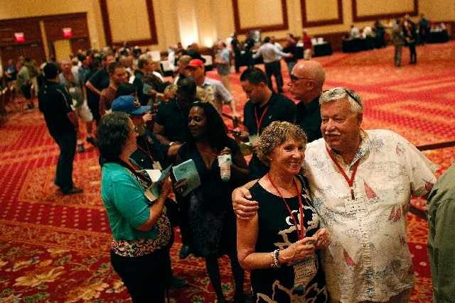Charles Williams, right, and Kathleen Williams stand in line to vote for candidates for the Clark County Republican Central Committee at the South Point in Las Vegas on Wednesday.