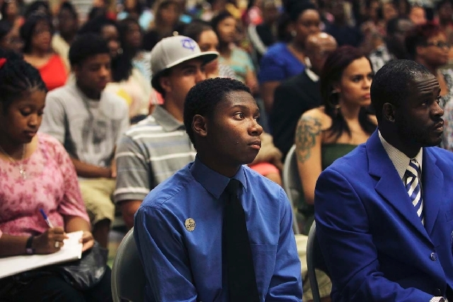16-year-old Elijah Henderson, middle, listens to a panel discussion about the ramifications of the George Zimmerman acquittal in the killing of Trayvon Martin during a meeting at the Pearson Commu ...