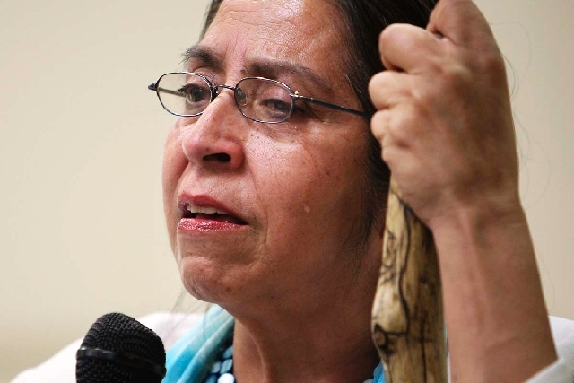 Vicenta Montoya sheds a tear while talking about the ramifications of the George Zimmerman acquittal in the killing of Trayvon Martin during a meeting at the Pearson Community Center in North Las  ...