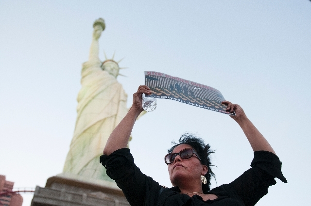 Rosa Mendoza, a Las Vegas activist, holds a sign in protest of a border militarization at an immigration rally on Wednesday in front of the New York-New York in Las Vegas.