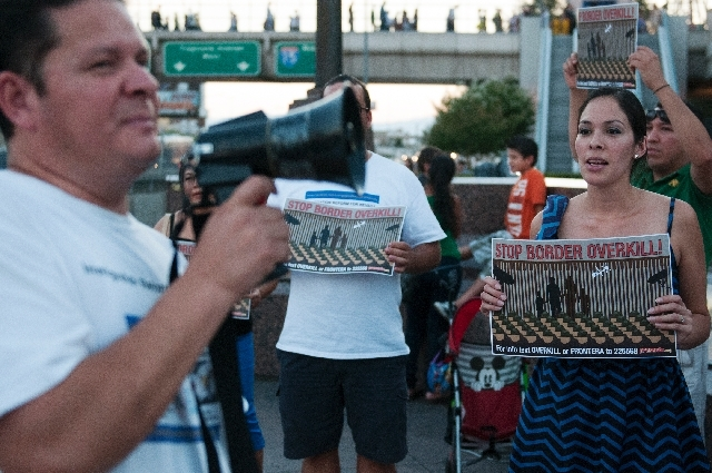 Carlos Silva, left, and Sandy Julian yell a chant during a demonstration protesting a border militarization at an immigration rally on Wednesday in front of the New York-New York in Las Vegas.